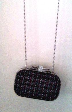 alt=<tweed clutch bag>