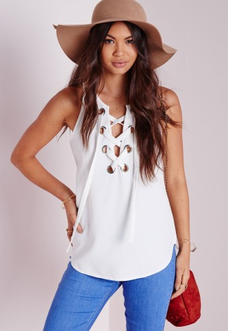 alt=<white lace-up top>