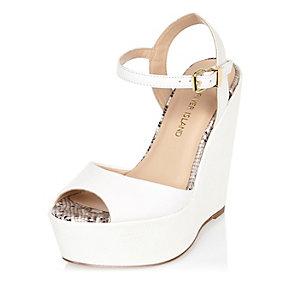 alt=<white platform shoe>