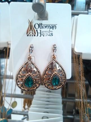 alt=<green drop earrings>