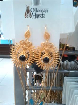 alt=<black and gold earrings>