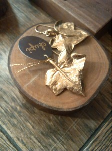 alt=<gold leaf earring>