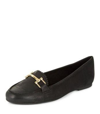alt=<black leather loafer>