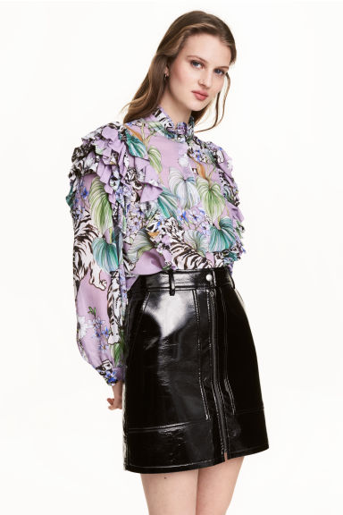 alt=< purple frilly blouse>